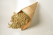 Buckwheat falling out of paper bag