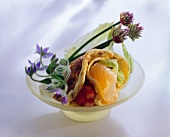 Filled pancake with salmon, salad leaves and tomato