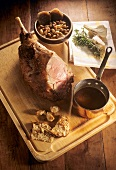 Braised leg of lamb with sauce pan on chopping board