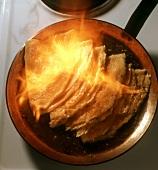 Flambéing crepes suzettes