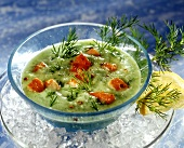 Chilled cucumber soup with fried salmon and dill