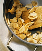 Toasting flaked almonds in a pan