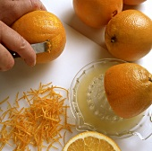 Squeezing and zesting orange halves