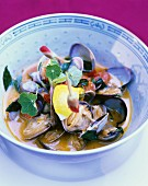 Mussels in curry sauce with nasturtium flowers