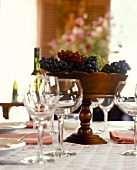 Bowl of grapes on laid table
