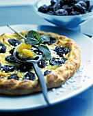 Small puff pastry tart with pineapple and prunes