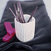 Chocolate matchsticks in a beaker