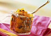 Pumpkin & mango chutney with pumpkin seeds in pickling jar
