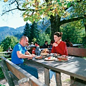 Couple in pub garden with snack and wine (Törgelegen)