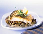 Fried catfish fillets on lentils