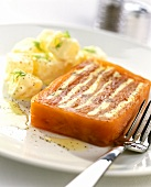 Smoked salmon terrine with herb butter; potato salad