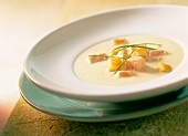 Cream of potato soup with salmon and croutons