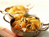 Pan-cooked potato and mushroom dish with sour cream