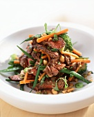 Beef and vegetable salad with peanuts