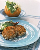 Crab cakes with salad garnish