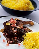 Roast duck leg with saffron rice and pomegranate sauce