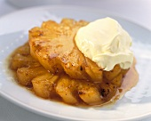 Caramelised pineapple slices with double cream
