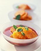 Orange slices in red wine sauce