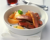 Pink roast duck breast with grapefruit segments