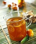Tea punch with kumquats