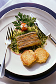 Meat and vegetable terrine with horseradish biscuits