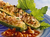 Courgettes with brown rice stuffing on tomato sauce