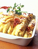 Baked crepes stuffed with white asparagus and ham