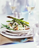 Roasted green asparagus on fish ragout