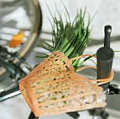 Garlic chives in shopping bag on a bicycle