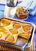 Pear quark cake, pieces cut on a baking tray