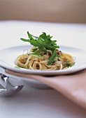 Spaghetti with tuna sauce and rocket