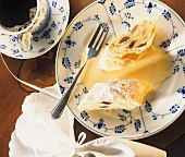 Two pieces of Karlsbad strudel with custard