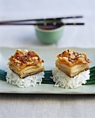 Chinese rice snacks with crispy pork pieces