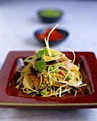 Asian rice noodles with vegetables, mushrooms, shrimps, ham