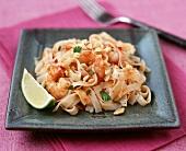 Stir-fried Asian noodles with nuts & prawns