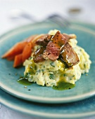 Strips of beef with herb sauce and herb mashed potatoes