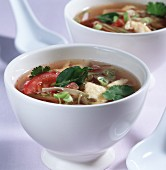 Asian tomato soup with egg and lime leaves