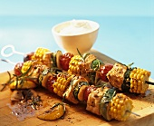 Turkey and vegetable kebabs and a bowl of tzatziki