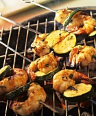 Shrimp and courgette kebabs on the barbecue