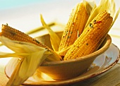 Barbecued corncobs with coriander and chili butter