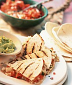 Barbecued tortillas with tomato & cheese filling and two sauces