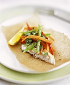 Fish fillet with vegetables braised in baking paper