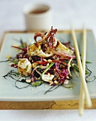 Cuttlefish with sesame and chili on Asian salad