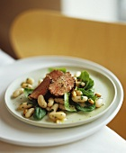 Lamb fillet on white bean and spinach salad