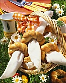 White bread rings as napkin holders in basket