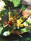 Vegetable kebabs on banana leaf and dip in leaf bowl