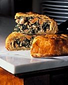 Pie filled with hare, goose liver and spinach