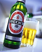 A bottle of Beck's beer with beer glass