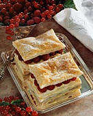 Puff pastries filled with raspberries and custard
