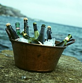 Assorted Bottles of Wine on Ice in a Brass Tub at the Beach